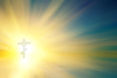 Religious cross with a rays of the sun