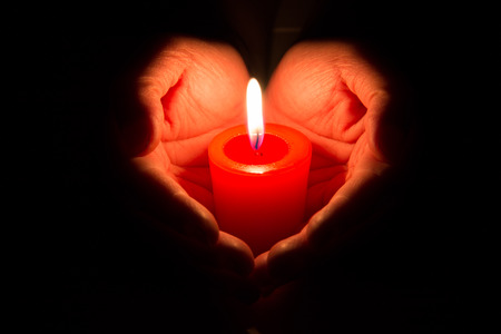 Photo for hands holding a burning candle - Royalty Free Image