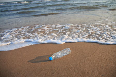 Photo for Plastic bottle on the beach - Royalty Free Image