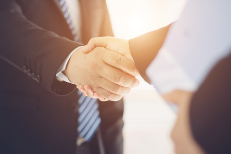 Photo for Business people shaking hands - Royalty Free Image