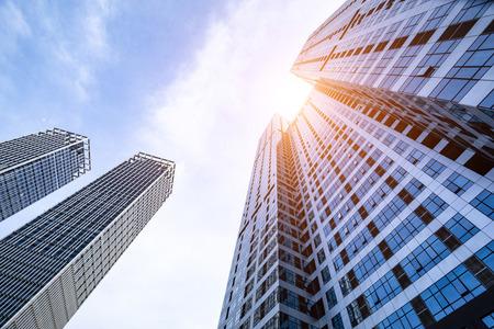 Photo pour Low angle shot of modern glass buildings - image libre de droit
