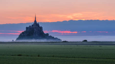 Mont Saint-Michel view in the sunrise light. Normandy, northern France