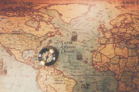 Photo pour Columbus day and world map with compass - image libre de droit