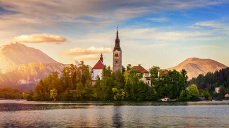 Photo for Lake Bled with St. Marys Church of Assumption on small island. Bled, Slovenia, Europe. The Church of the Assumption, Bled, Slovenia. The Lake Bled and Santa Maria Church near Bled, Slovenia. - Royalty Free Image