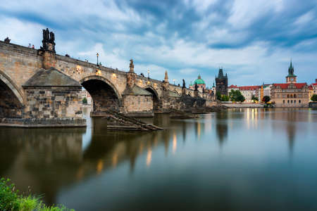 Photo for Charles Bridge in Prague in Czechia. Prague, Czech Republic. Charles Bridge (Karluv Most) and Old Town Tower. Vltava River and Charles Bridge. Concept of world travel, sightseeing and tourism. - Royalty Free Image