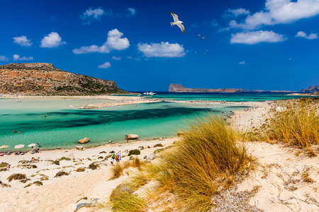 Photo for Balos Lagoon and Gramvousa island on Crete with seagulls flying over, Greece. Cap tigani in the center. Balos beach on Crete island, Greece. Crystal clear water of Balos beach. - Royalty Free Image