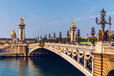 Photo pour Pont Alexandre III bridge over river Seine in the sunny summer morning. Bridge decorated with ornate Art Nouveau lamps and sculptures. The Alexander III Bridge across Seine river in Paris, France. - image libre de droit