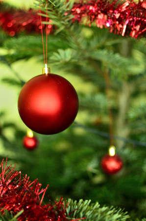 Photo pour Red Christmas Bauble on The Christmas Tree - image libre de droit