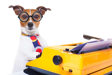 Photo pour jack russell secretary dog typing on a typewriter keyboard ,isolated on white background - image libre de droit