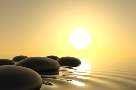 Zen stones into the water with sunset on background