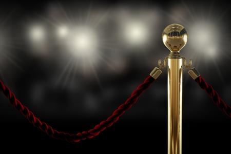 Photo pour Red velvet rope barrier close-up with flash light on background - image libre de droit