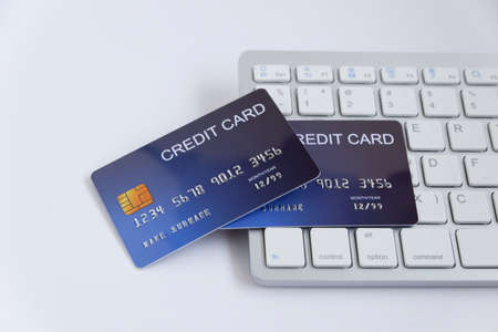 Photo pour Credit card on computer keyboard on white desk. Concept of Online shopping and payment. - image libre de droit