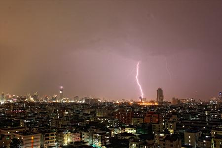 Lightening strikes during an evening monsoon storm in Bangkok, Thailand.