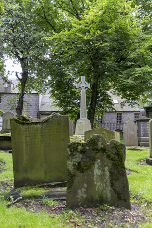 Grave stones and green trees at the  Kirk of Saint Nicholas Uniting.