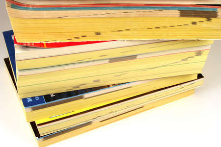 Stack of phone directories on a white background