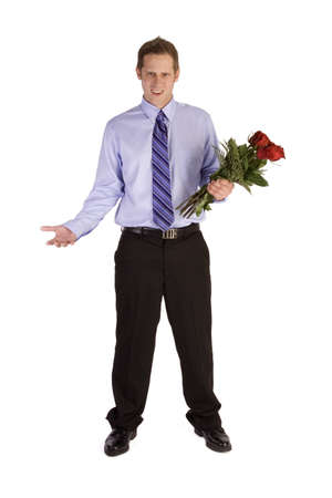 Young man holding flowers on white looking rejected.