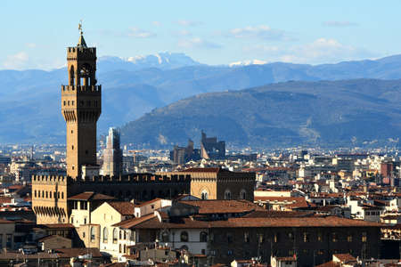 Palazzo Vecchio on piazza della Signora in the morning as seen from Piazzale Michelangelo. Florence, Italy.