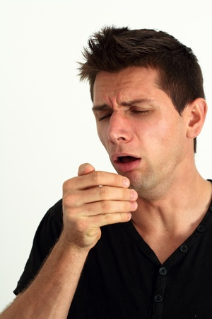 Sick man coughing into he