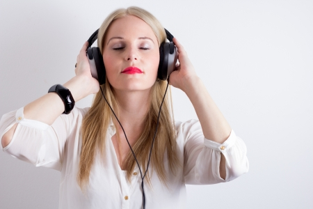 Image of Woman Listening To Music With Headphines
