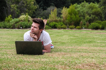 Man working on Notebook outdoors in park