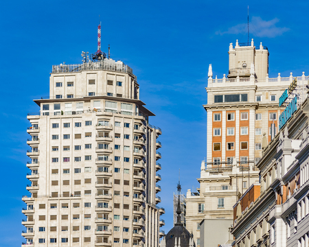 Low angle view of famous edificio españa surrounded by other apartment buildings at Madrid city, Spain