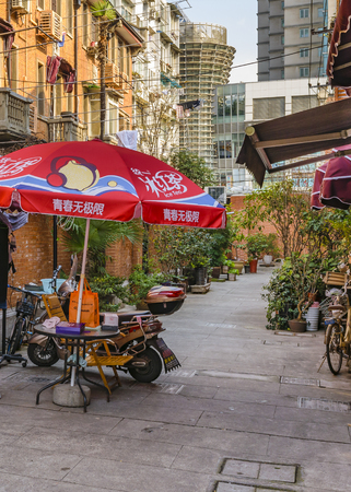 SHANGHAI, CHINA, DECEMBER - 2018 - Urban winter day scene at condo in the famous french concession zone in shanghai city, china