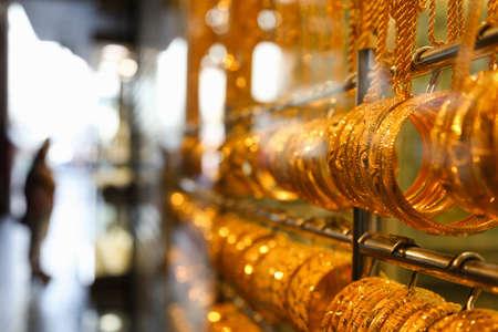 Gold bangles in a Dubai gold souk  United Arab Emirates