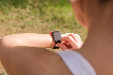 Photo pour Wearable technology sports devices suit Hispanic girl using phone to listen to music with headphones and smart watch. Technology in fitness banner panorama. Active lifestyle. - image libre de droit