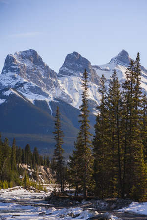 Photo for Canada scenic Landscape view with The Three Sisters Peaks, landmark in Canmore, Alberta - Royalty Free Image