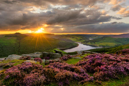 Photo for Evening sun bursting through dramatic clouds with epic view of Ladybower Reservoir in the Peak District. - Royalty Free Image