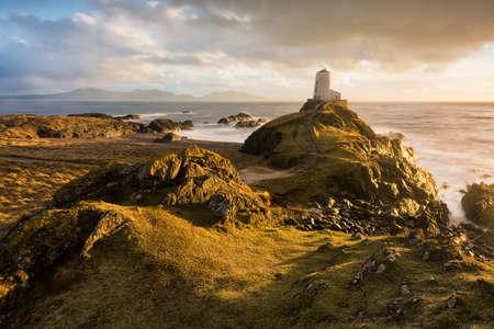 Photo pour Llanddwyn Island Lighthouse with beautiful evening golden light after a rain storm. - image libre de droit