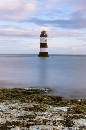 Photo pour Penmon Point Lighthouse on the Isle of Anglesey in North Wales, UK. - image libre de droit