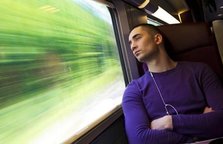 Photo pour Portrait of a young handsome man in the train - image libre de droit