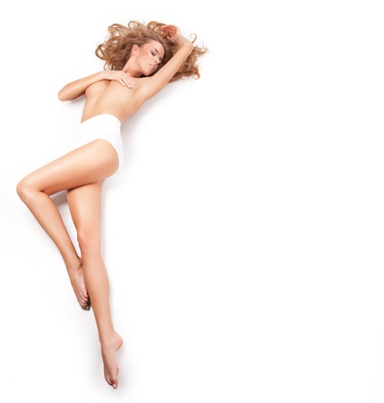 Photo for Delicate blond woman lying on a white background - Royalty Free Image