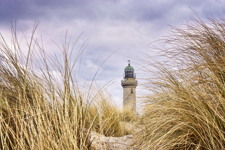 Foto de Very close to the grass with lighthouse in the background. Warnem?nde, Germany - Imagen libre de derechos
