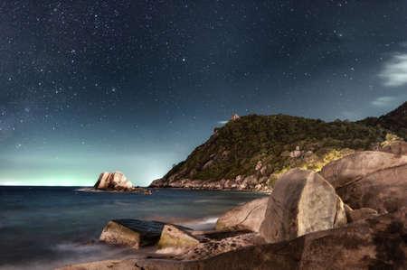 night sky sea rocks beach.