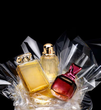 Generic perfume bottles in a gift set on black background