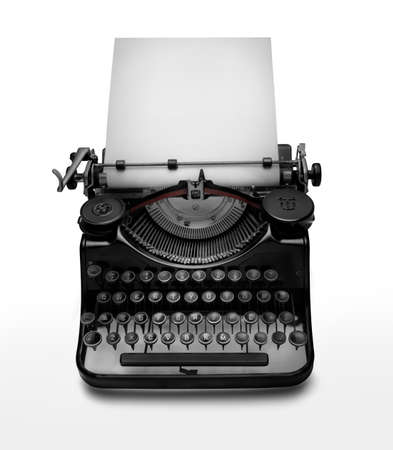 Photo pour Vintage typewriter aginst white background. Low key edition of an ancient typewriter to give prominence to the space for text at the white page. Clipping path on typewriter - image libre de droit