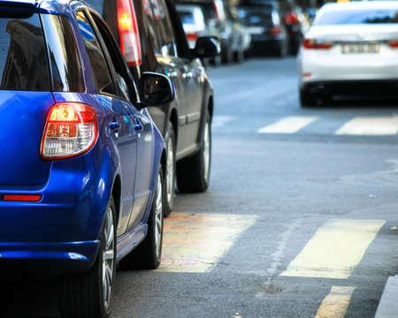 Photo pour Rear light of blue color modern car on road. - image libre de droit