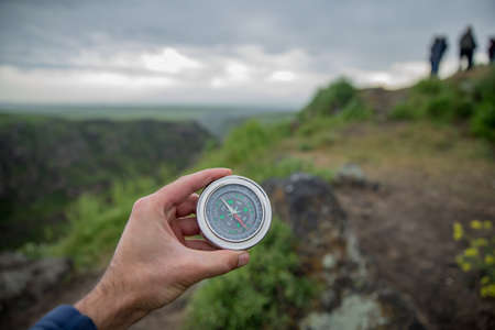 Photo for man holding compass in nature background - Royalty Free Image
