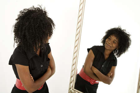 Lady looking at herself in mirror confidently