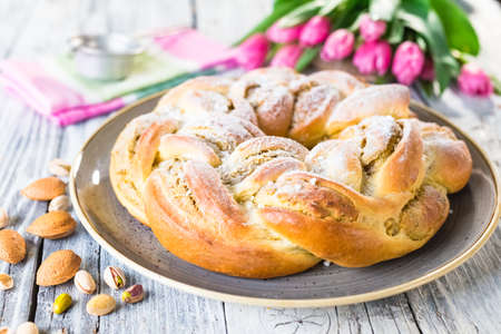 Sweet braided easter bread with marzipan and pistachio