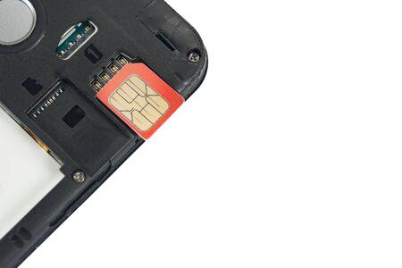 Photo pour SIM card close-up next to the connector in the smartphone, phone - image libre de droit