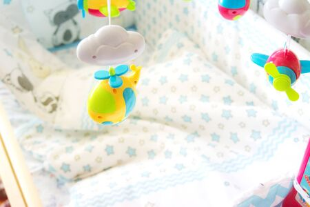Photo pour children's mobile toy for a cradle in the nursery on a light background, a toy for development of kids, a bedside toy - image libre de droit