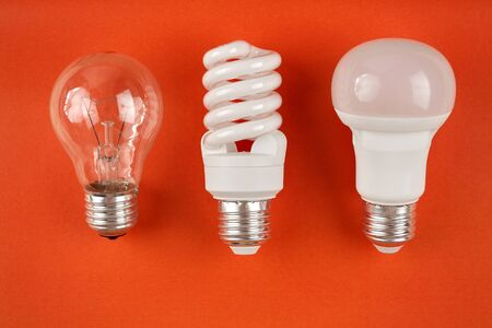 Photo for generations of light bulbs from incandescent and halogen bulbs to led bulbs, modern energy-saving technologies and environmental protection - Royalty Free Image
