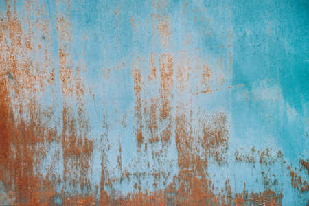 Foto de Rust on metallic surface. Iron texture. Partly rusty background. Rough oxide plate close-up. Hard decay of metal. Oxidation of steel. Chemical reaction. Partially rusted metal panel with peeling paint - Imagen libre de derechos