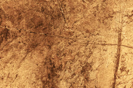 Photo for Vintage yellow background. Rough painted wall of aspen gold color. Imperfect plane of golden colored. Uneven old decorative toned backdrop of yellow tint. Texture of gold hue. Ornamental stony surface - Royalty Free Image