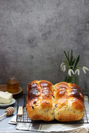 Photo for Traditional hot cross buns with honey and butter on a concrete background. - Royalty Free Image