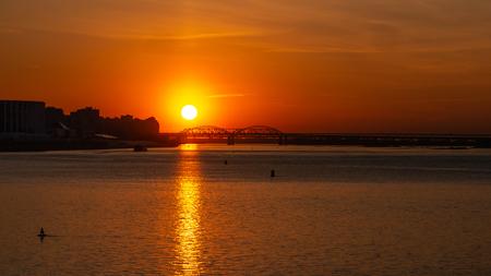 Photo pour Beautiful sunset over the big river. Big city and bridge on the background. Copyspace for text. - image libre de droit