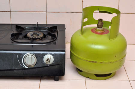 Photo for Indoenesia 3 kg gas cylinder and gas stove - Royalty Free Image